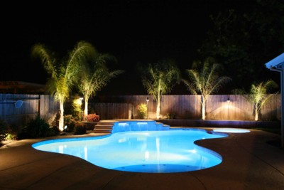 Beautiful_backyard_lighting_and_colored_pool_lights